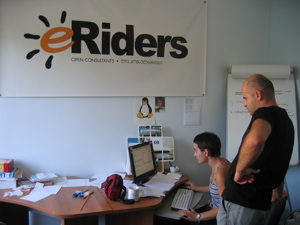 Taya and Zviad in the eRider office
