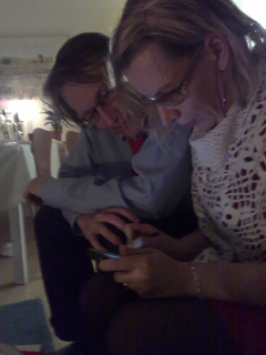 Jyrki and Outi huddled around the Internet Tablet